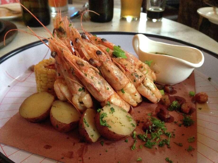 Shrimp boil with pork jowl, potatoes and corn Photo: Edmund Tijerina, San Antonio Express-News