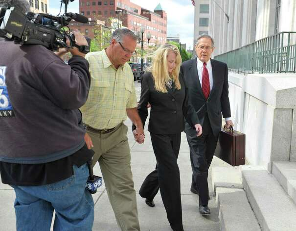 Larry Wormuth, left, his wife, former Halfmoon Supervisor Melinda Wormuth, second from left,  and her attorney E. Stewart Jones make their way into Federal Court for a suppression hearing on Wednesday, May 13, 2015, in Albany, N.Y.   (Paul Buckowski / Times Union) Photo: PAUL BUCKOWSKI / 00031804A