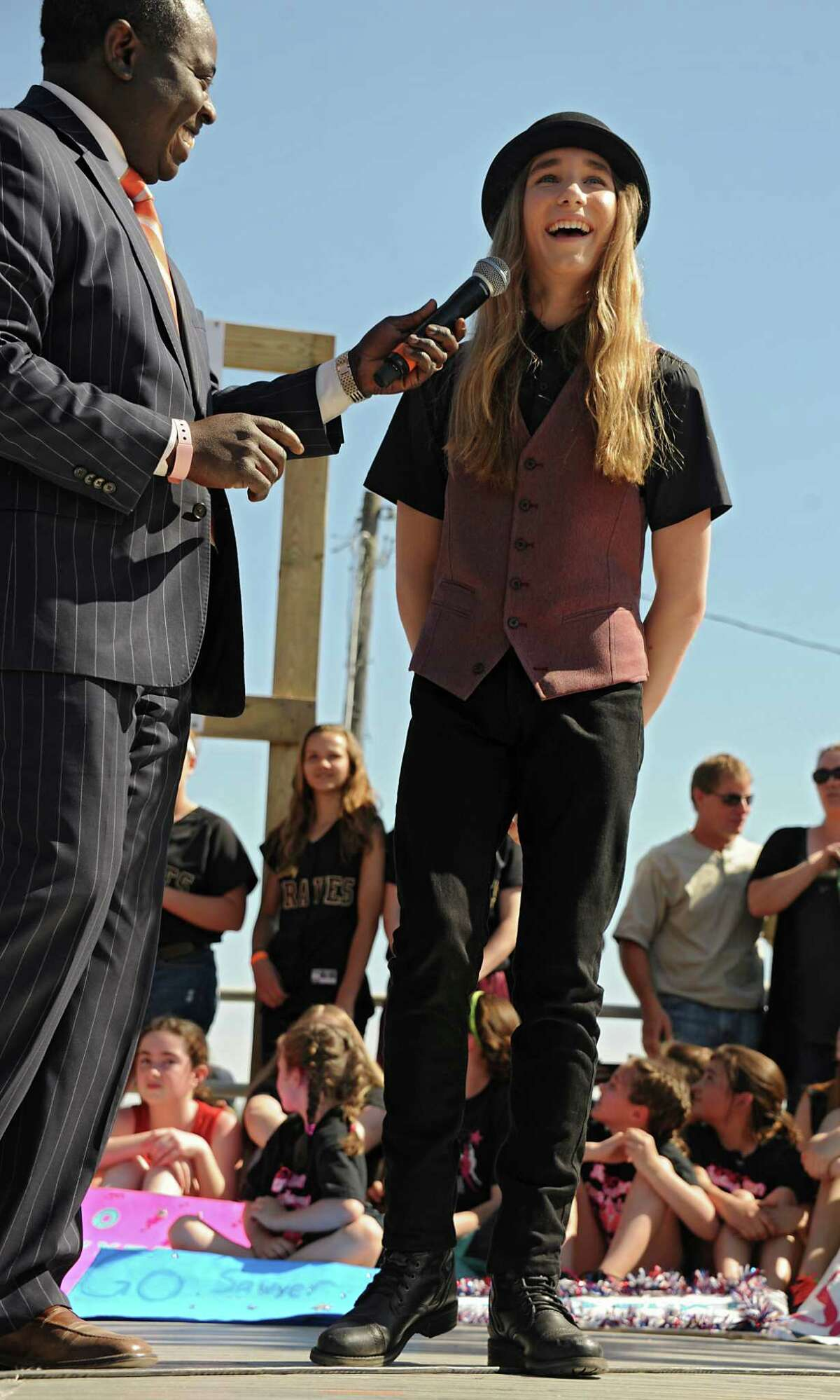 Dan Bazile of WNYT Channel 13 interviews Fultonville's own Sawyer Fredericks before Sawyer performs at the Fonda Speedway on Wednesday, May 6, 2015 in Fonda, N.Y. The 16-year-old singer/songwriter is one of the final six contestants on NBC's show The Voice. (Lori Van Buren / Times Union)