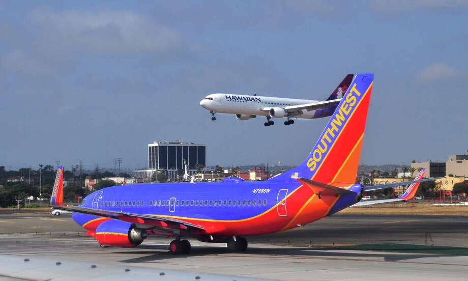 File photo on May 16, 2013 of Southwest Airlines Boeing 737 aircraft. A UC Berkeley student who was removed from a Southwest Airlines plane after a fellow passenger heard him speaking in Arabic on his mobile phone Photo: Robert Alexander, Getty Images / 2013 Robert Alexander
