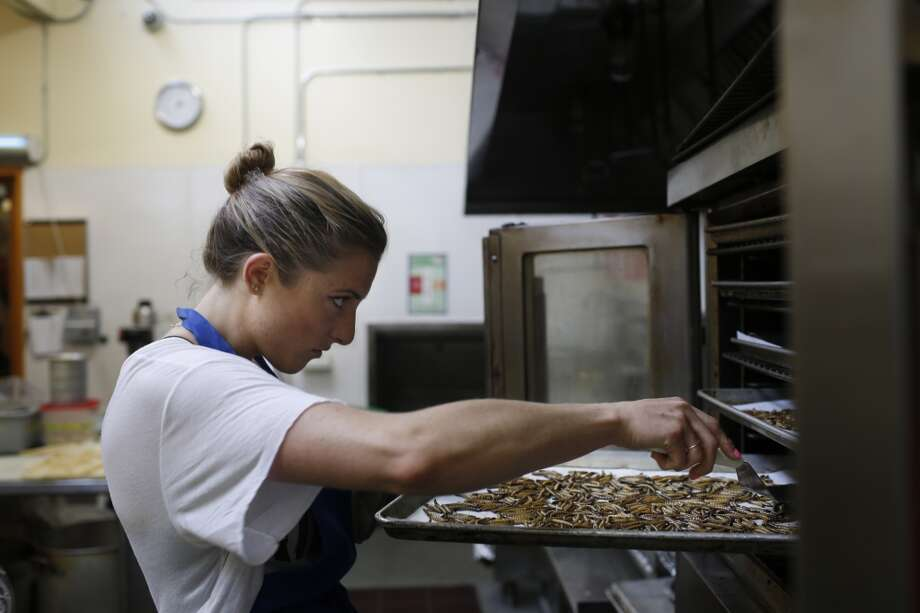 Genevieve Gladson, Don Bugito production, checks on mealworms toasting in the oven at La Cocina on Thursday, May 7, 2015 in San Francisco, Calif. Photo: The Chronicle