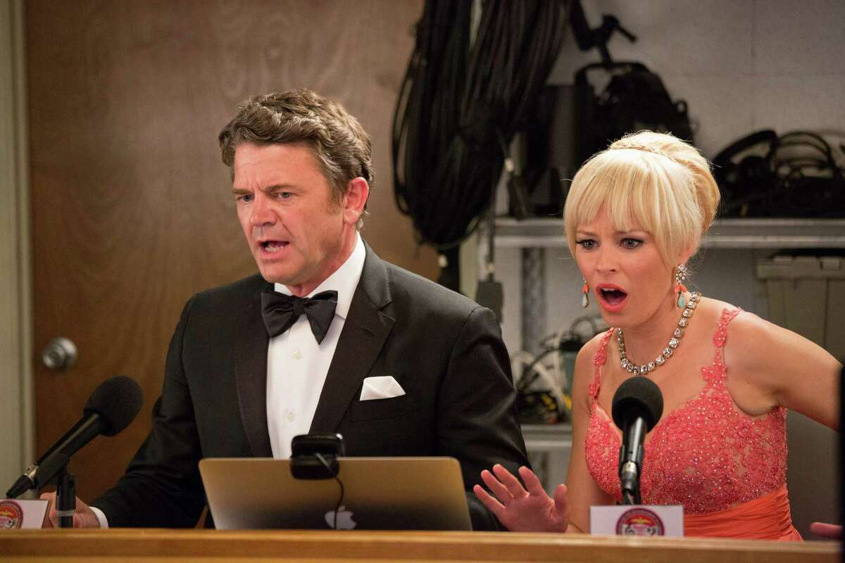 Snippy commentators John Michael Higgins as John and Elizabeth Banks as Gail. Banks also directed the sequel.