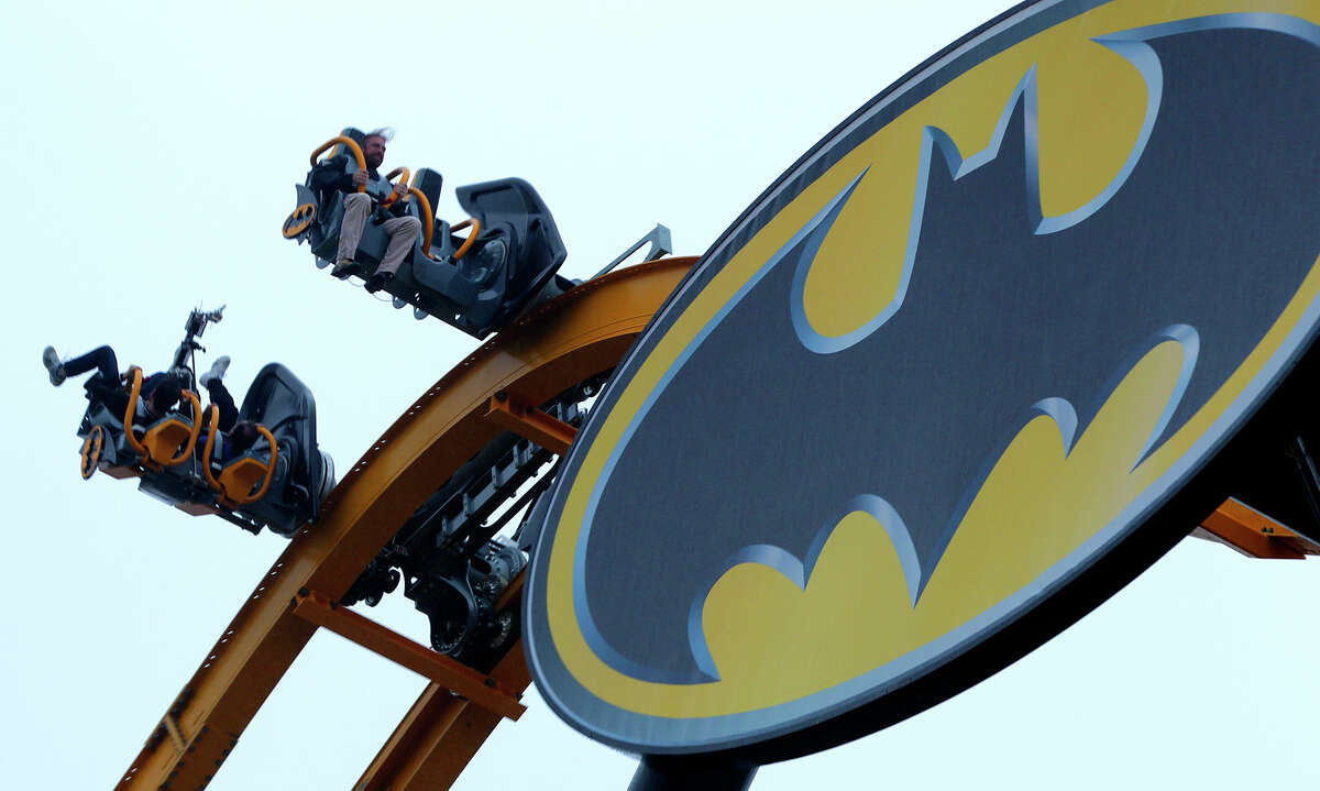 People ride Wednesday May 13, 2015 on the new roller coaster at Six Flags Fiesta Texas called Batman: The Ride. Members of the media had access to the new ride called a 4D Wing Coaster that flips riders head-over-heels at least six times.