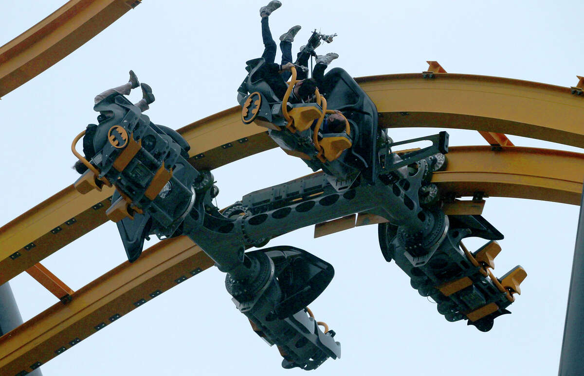 People ride Wednesday May 13, 2015 on the new roller coaster at Six Flags Fiesta Texas called Batman: The Ride. Members of the media had access to the new ride called a 4D Wing Coaster that flips riders head-over-heals at least six times.