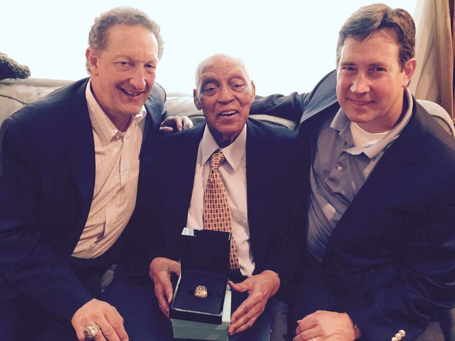 Former New York Giants outfielder Monte Irvin, now 96, received a World Series ring at his daughter's West Houston home on May 13, 2015. Also present were team president Larry Baer and general manager Bobby Evans Photo: John Shea, The Chronicle