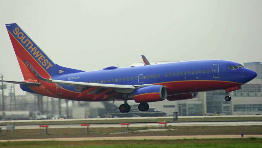 A Southwest Airlines Boeing 737 lands at Hobby Airport in March 2015. Photo: Bill Montgomery