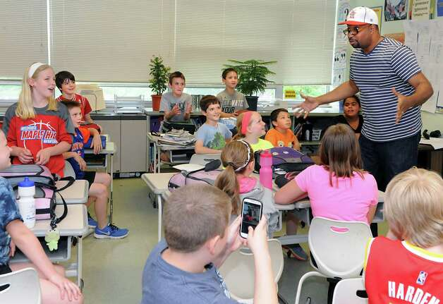 "Newbery Medal winning author Kwame Alexander talks to 5th graders as he visits Castleton Elementary School on Wednesday, May 13, 2015 in Castleton, N.Y. Kwame won the 2015 Newbery Medal for best children's book in the country. Mr. Alexander's book ""The Crossover"" is written entirely in poetry verse and tells the story of twin brothers on a junior high basketball team as they struggle with their father's declining health. (Lori Van Buren / Times Union) Photo: Lori Van Buren / 00031814A"