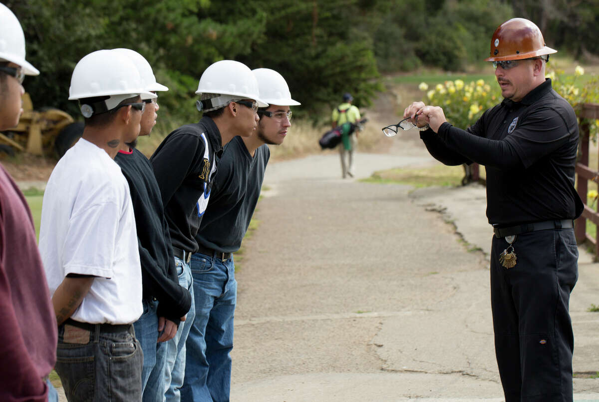 Ken Mochida instructs at-risk youth in the use of power tools and teaches agrarian studies at Gleneagles Golf Course, where the students put the lessons into action.