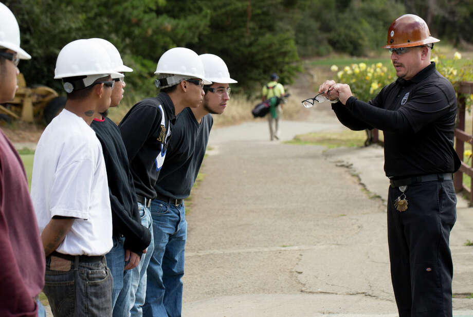 Ken Mochida instructs at-risk youth in the use of power tools and teaches agrarian studies at Gleneagles Golf Course, where the students put the lessons into action. Photo: Tim Hussin / Special To The Chronicle / ONLINE_YES