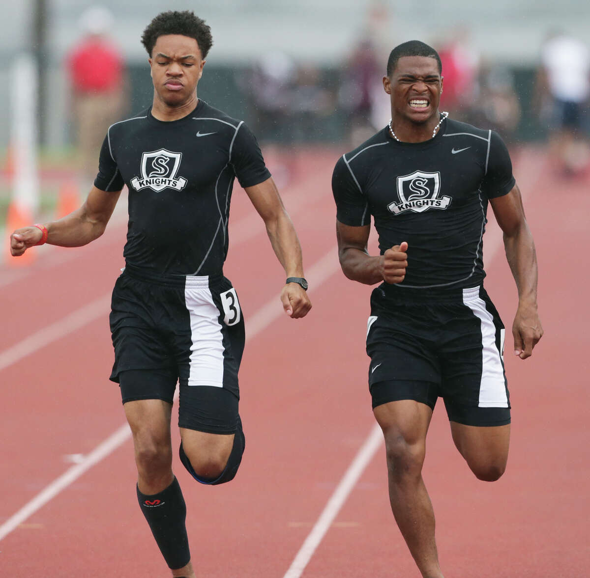 Steele sprinter Andrew Hudson (left) beats teammate Bryson Denley by a hundredth of a second in the 100 meter race as districts 25/26-6A and 27/28-6A hold area track meets at Gustafson Stadium on April 24, 2015.
