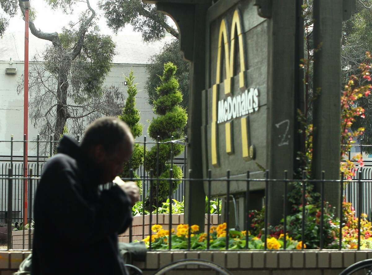 A man pipe smokes outside the McDonald's at Haight and Stanyan streets, Wednesday, May 13, 2015, in San Francisco, Calif. S.F. City Attorney Dennis Herrera is threatening legal action against McDonalds for the drug dealing that goes on outside the store.