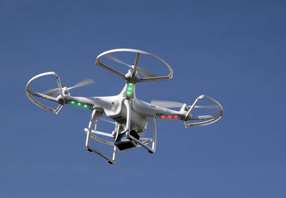 Drones like this could pose serious hazards to commer cial flights and small planes. Photo: Jae C. Hong / Associated Press / AP