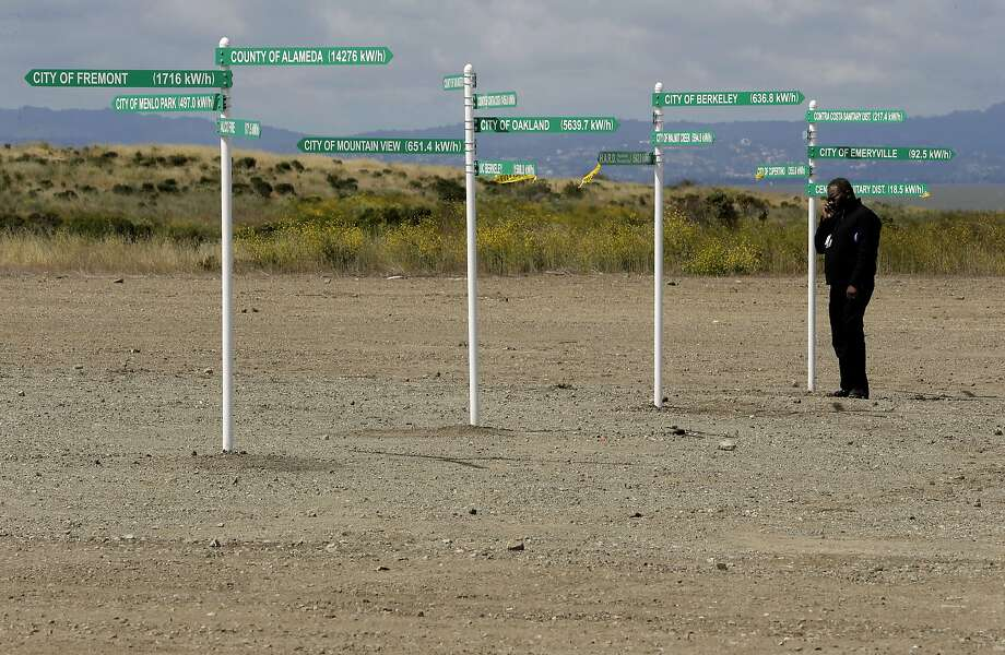 Andre Benson with Alameda County Services along a row of signs showing Bay Area cities and counties associated with the nation's first federal solar partnership, which was announced by United States EPA Administrator Gina McCarthy during a visit to the West Winton Landfill property in Hayward, Calif., on Wed. May 13, 2015. Plans are to install 19,000 solar panels on the landfill site. Photo: Michael Macor, The Chronicle