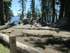 Rambob Stienstra checks out campsite at Lake of the Woods, a short backpack-style hike from Echo Lakes, in Desolation Wilderness, located near U.S. 50 in the central Sierra Nevada west of Tahoe.