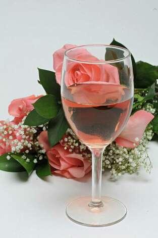Rose wine with roses on Tuesday, May 12, 2015 in Colonie, N.Y. (Lori Van Buren / Times Union) Photo: Lori Van Buren / 00031805A