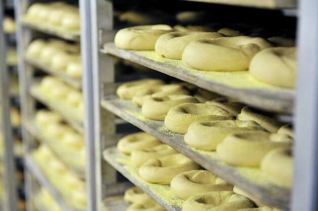 Uncooked bagels are seen on racks in the cooler at Bagels and Bakes on Thursday, May 7, 2015, in Schenectady, N.Y.  The cooler holds the bagels for the next day.  Avery said that on average they are making up 150 dozen bagels a day but some days they are producing 250 dozen.  (Paul Buckowski / Times Union) Photo: PAUL BUCKOWSKI / 00031740A