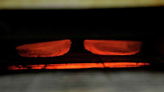 A sesame seed bagel goes through the toaster at Bagels and Bakes on Thursday, May 7, 2015, in Schenectady, N.Y.  (Paul Buckowski / Times Union) Photo: PAUL BUCKOWSKI / 00031740A