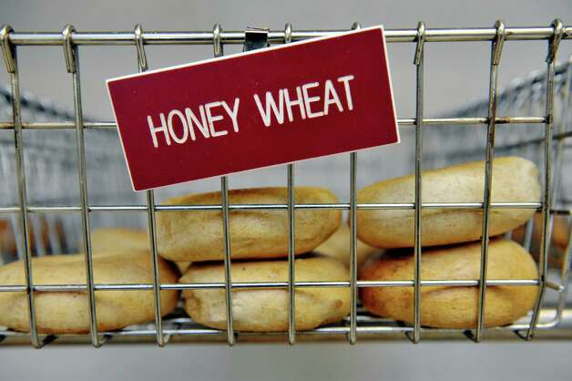 Honey wheat bagels are seen in a wire basket at Bagels and Bakes on Thursday, May 7, 2015, in Schenectady, N.Y.  (Paul Buckowski / Times Union) Photo: PAUL BUCKOWSKI / 00031740A