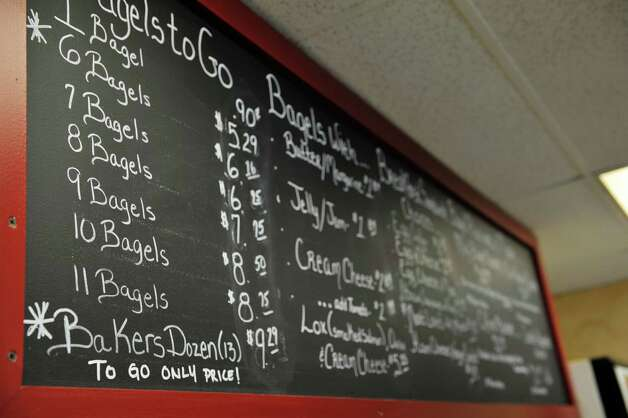 A view of the menu board at Bagels and Bakes on Thursday, May 7, 2015, in Schenectady, N.Y.  (Paul Buckowski / Times Union) Photo: PAUL BUCKOWSKI / 00031740A