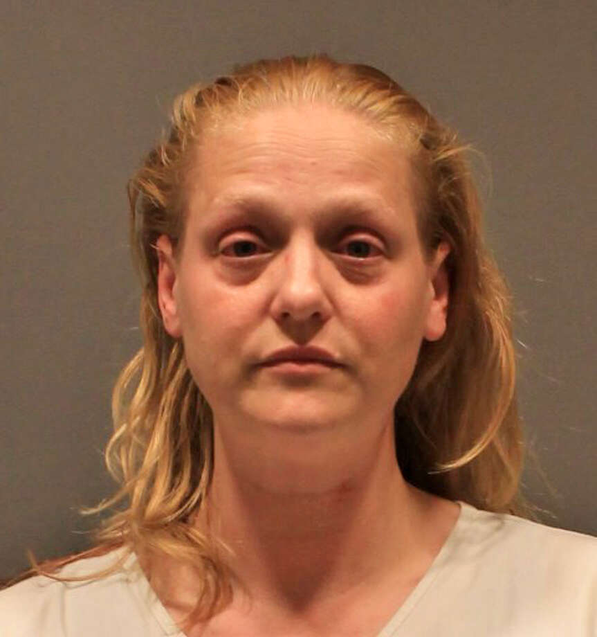 Police said Jaime Fitcher, who was in charge of the medication cart at Lord Chamberlain nursing and rehabilitation center,  was replacing patients' prescription medication with Tylenol and Claritin. Fitcher, 39, of Balance Rock Road, Seymour, was charged Tuesday with first-degree reckless endangerment, cruelty to persons, illegally obtaining narcotics, illegal possession of narcotics, possession of a controlled substance and misrepresentation of a controlled substance. Photo: Contributed Photo, Stratford Police Dept / Connecticut Post Contributed