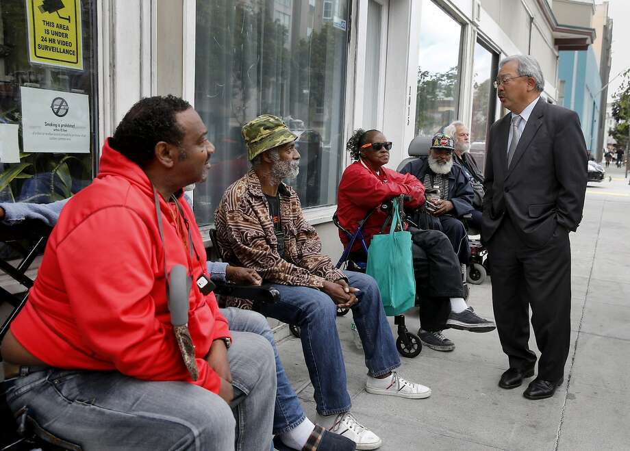 Mayor Ed Lee stopped to talk with residents of the Raman Hotel on Howard Street where he made the announcement Wednesday May 13, 2015. Mayor Ed Lee and members of the Board of Supervisors announced $28.9 million in new funding over the next two years to support the homeless in San Francisco, Calif. including the addition of more than 500 supportive housing units for chronically homeless seniors, expand medical care and continue the new Navigation Center. Photo: Brant Ward, The Chronicle