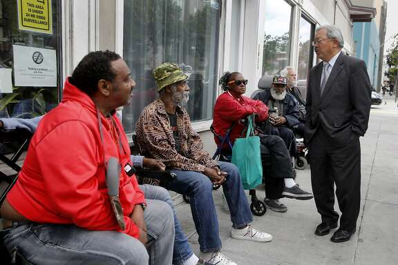 Mayor Ed Lee stopped to talk with residents of the Raman Hotel on Howard Street where he made the announcement Wednesday May 13, 2015. Mayor Ed Lee and members of the Board of Supervisors announced $28.9 million in new funding over the next two years to support the homeless in San Francisco, Calif. including the addition of more than 500 supportive housing units for chronically homeless seniors, expand medical care and continue the new Navigation Center.