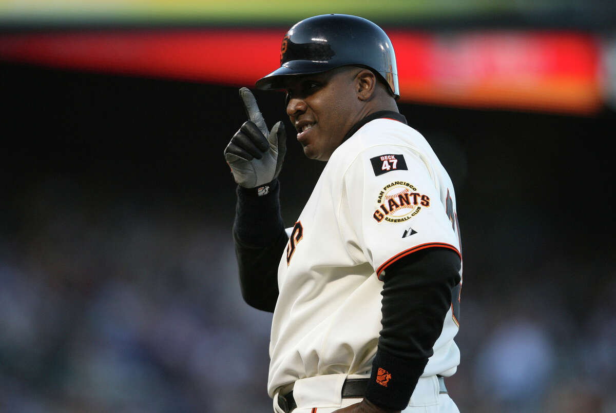 Barry Bonds gestures to someone in the stands after a first-inning walk in August 2007. Bonds hit 28 home runs with a league-high 132 walks in what would be his final season.
