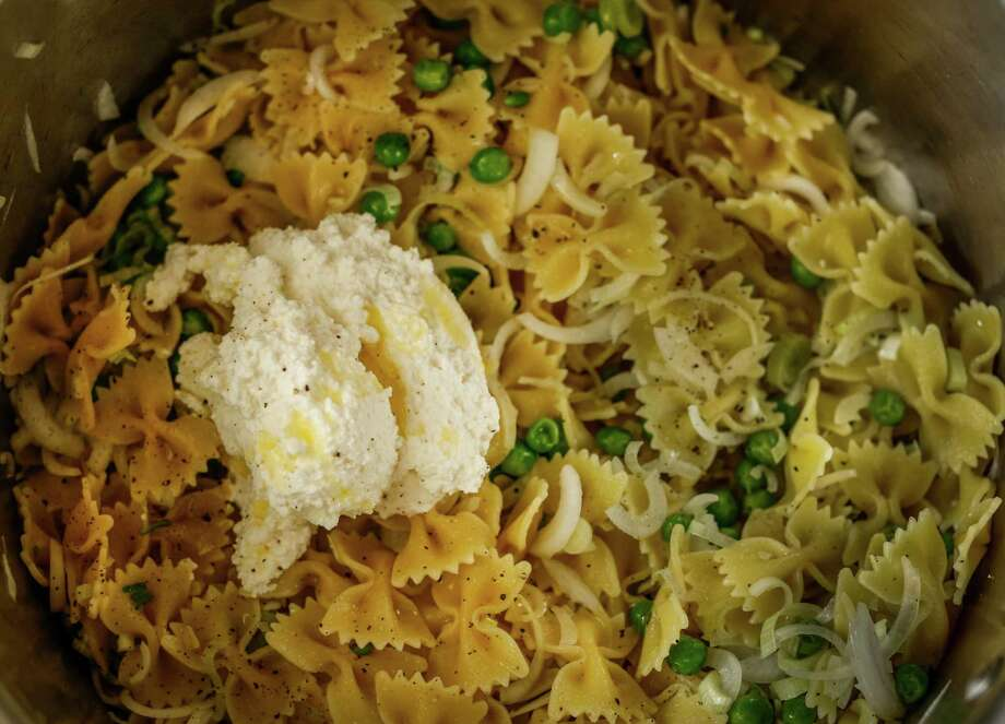 Farfalle with spring onions, peas and ricotta Photo: Russell Yip / The Chronicle / ONLINE_YES