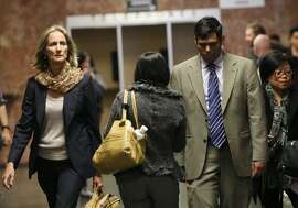 Enrique Pearce, right, and his lawyer Eileen Burke head into a courtroom inside the Hall of Justice, Wednesday, May 13, 2015, in San Francisco, Calif. Pearce a political consultant for S.F. Ed Lee, was arraigned on child porn possession charges. He pleaded not guilty. Pearce was taken into custody after being deemed a public safety risk by the prosecutor. Bail was set to $400,000.