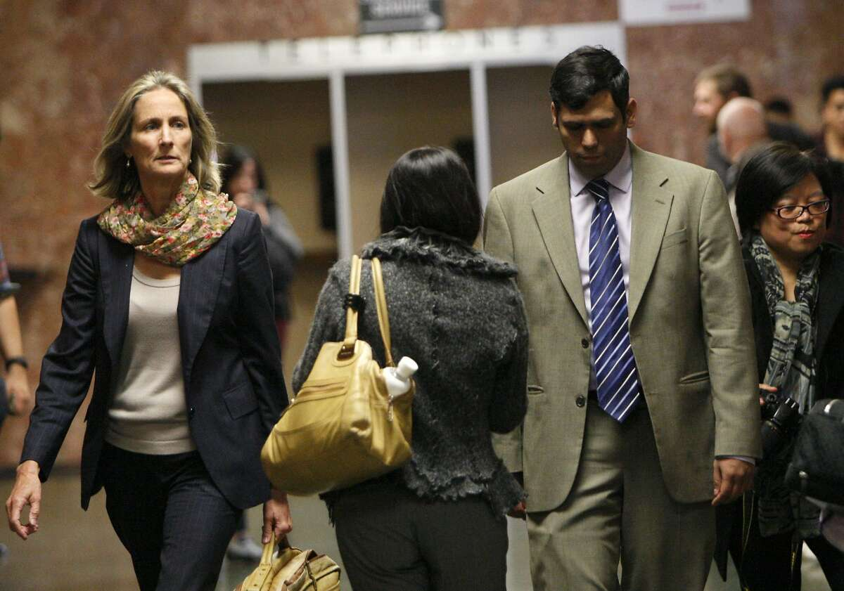 Enrique Pearce, right, and his lawyer Eileen Burke head into a courtroom inside the Hall of Justice, Wednesday, May 13, 2015, in San Francisco, Calif.
