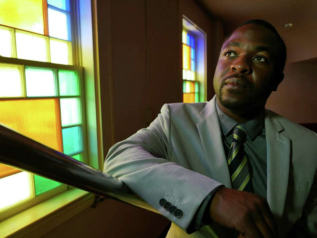 Taj Matthews pauses at Mount Zion First Baptist Church, pastored by his grandfather the Rev. Claude Black.