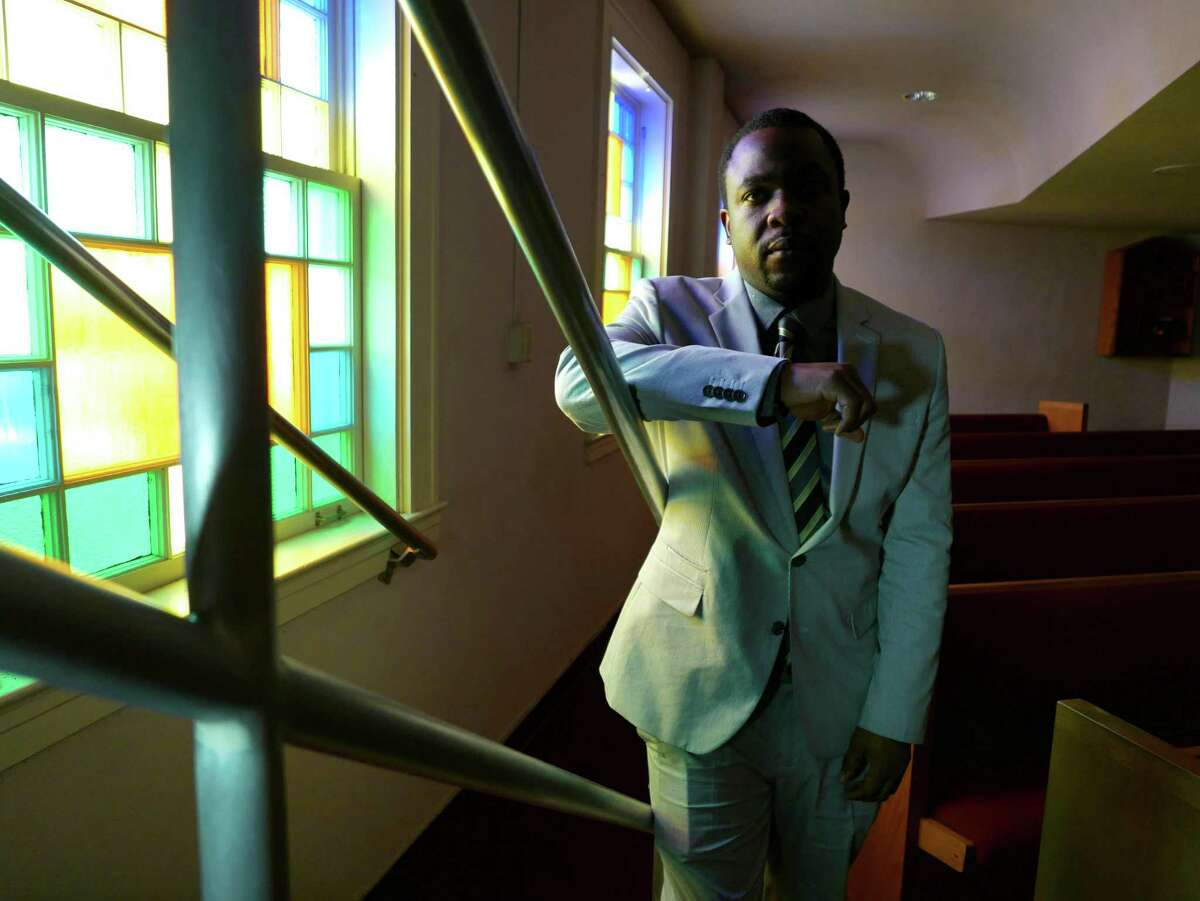 Taj Matthews, a community activist, stands in Mount Zion First Baptist Church, which his grandfather, the Rev. Claude Black, pastored. April 7, 2015.