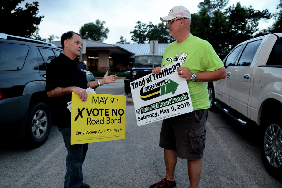 Former Texas Rep. Steve Toth, left, and Walt Sass expressed their difference of opinion during campaigning for May's road bond election earlier this year. That road bond was defeated by voters. Photo: Jerry Baker, Freelance