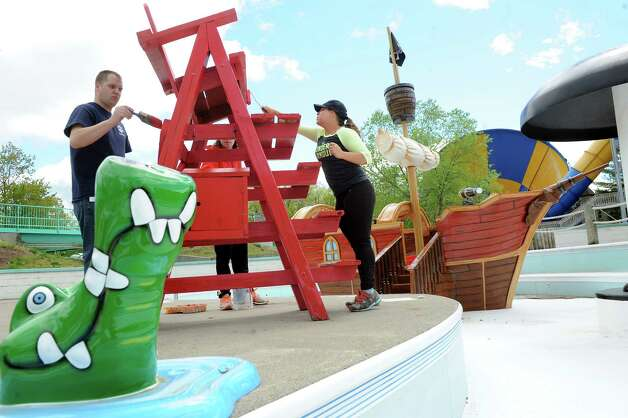 Great Escape employees Michael Hay, left, Quinn Beattie, center, and Emilie Gorham paint a life guard chair at the new Buccaneer Beach waterpark on Wednesday, May 13, 2015, at Great Escape in Queensbury, N.Y. (Cindy Schultz / Times Union) Photo: Cindy Schultz / 00031796A