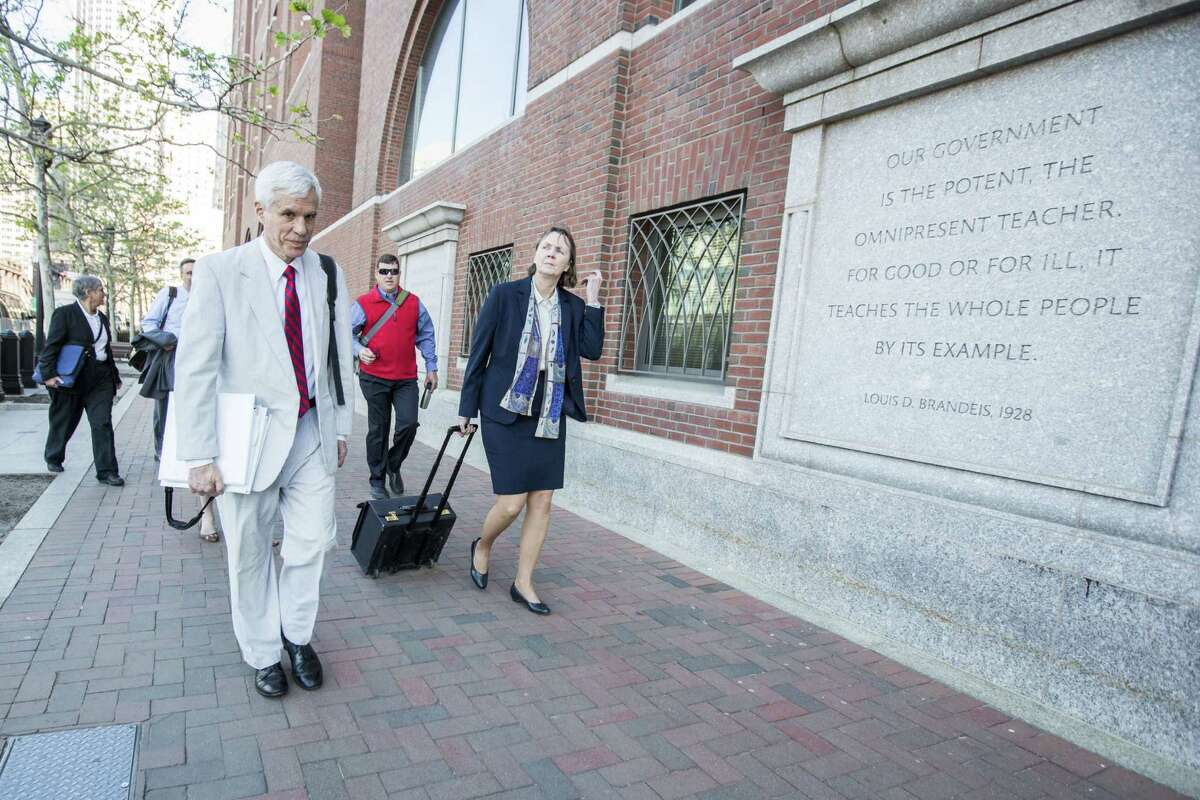 Members of the legal defense team for Boston Marathon bomber Dzhokhar Tsarnaev, including David Bruck, (left) and Judy Clarke (right) arrive at the federal courthouse in Boston before closing arguments begin. Dzhokar Tsarnaev was found guilty on all 30 counts related to his involvement in the 2013 bombing, which resulted in three deaths and over 250 injuries.