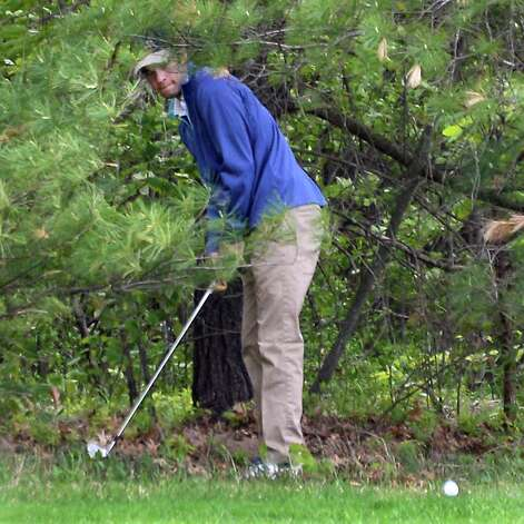 Austin Teal hits his ball out of the woods during the annual Challenge Cup pros vs. amateurs team competition between the Northeastern New York PGA and the Capital Region Amateur Golf Association at the Edison Club Wednesday May 13, 2015 in Rexford, NY.  (John Carl D'Annibale / Times Union) Photo: John Carl D'Annibale / 00031818A
