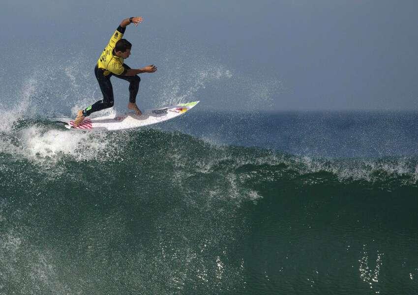 Brazil's Adriano de Souza competes in the 2015 Oi Rio Pro World Surf League competition at Barra da Tijuca beach in Rio de Janeiro, Brazil, Tuesday, May 12, 2015.
