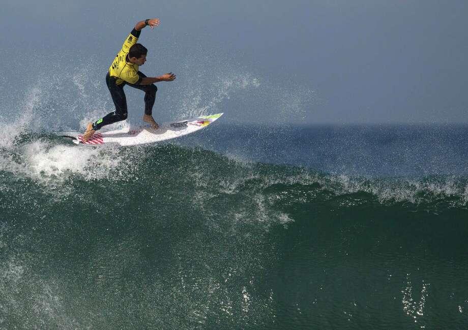 Brazil's Adriano de Souza competes in the 2015 Oi Rio Pro World Surf League competition at Barra da Tijuca beach in Rio de Janeiro, Brazil, Tuesday, May 12, 2015.  Photo: Leo Correa, Associated Press / AP