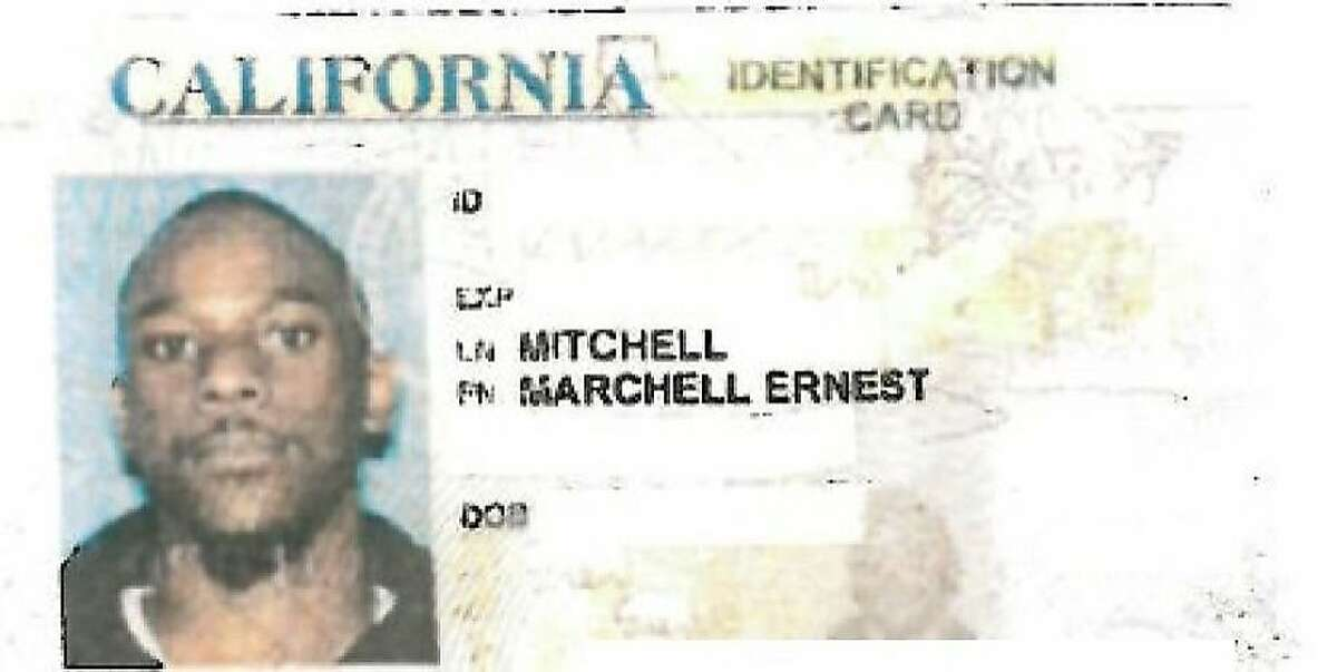 The redacted ID card of former Oakland High School security guard Marchell Mitchell, accused of handcuffing, punching and dumping a student out of his wheelchair