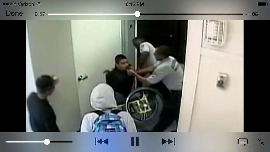 Oakland High School  surveillance video apparently showing security guard Marchell Mitchell attacking a  student in a wheelchair Photo: Oakland Unified School District