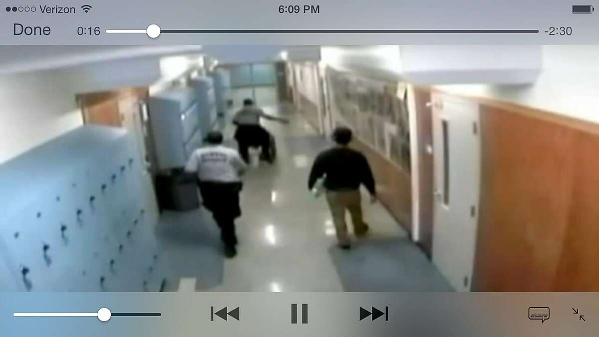 Oakland High School surveillance video apparently showing security guard Marchell Mitchell attacking a student in a wheelchair