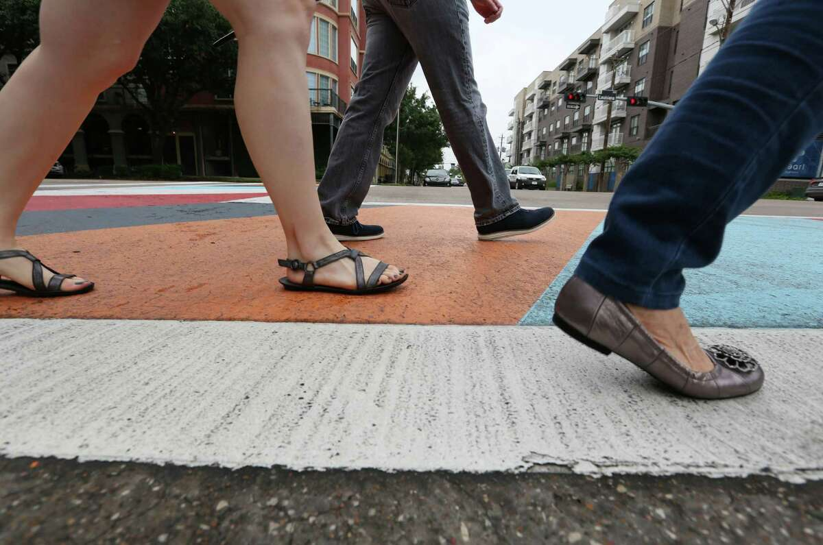 Pedestrians cross at a new artistic crosswalk. Such decorated crosswalks are becoming more common across the U.S.