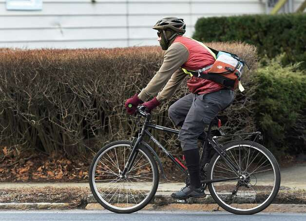 A bicycle commuter rides east on Western Avenue April 6, 2015, in Albany, N.Y.   (Skip Dickstein/Times Union archive) Photo: SKIP DICKSTEIN / 00031321A