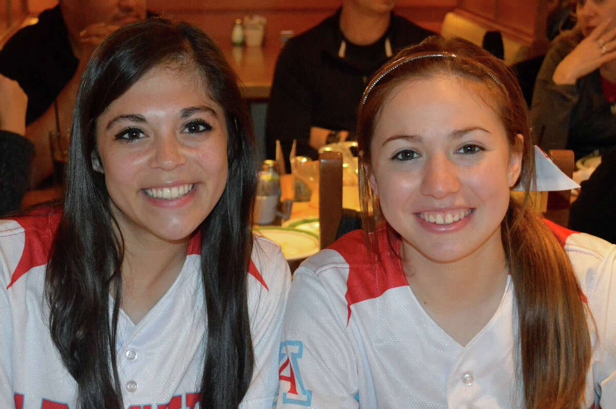 Antonian softball players Madison Gaona (left) and Christen Martinez (right) pose for a photo.
