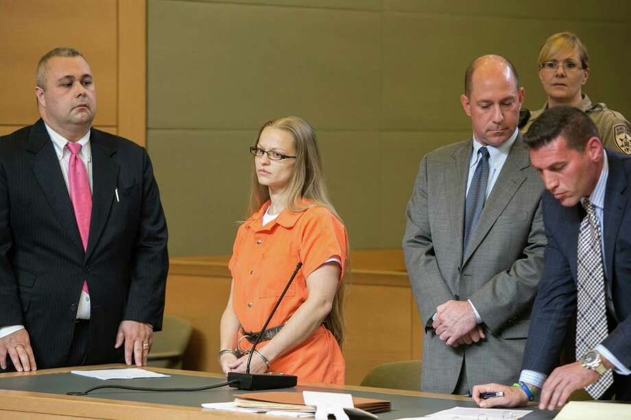 Angelika Graswald, second from left, stands in court with Michael Archer, left, a forensic scientist, as her attorneys Jeffrey Chartier and Richard Portale, right, ask for bail and to unseal the indictment against her, during a hearing Wednesday, May 13, 2015, in Goshen, N.Y.  Graswald has been charged with second-degree murder in the disappearance of her fiance, Vincent Viafore while kayaking on the Hudson River. (Allyse Pulliam/Times Herald-Record via AP, Pool) ORG XMIT: NYMID206 Photo: Allyse Pulliam / Pool Times Herald-Record