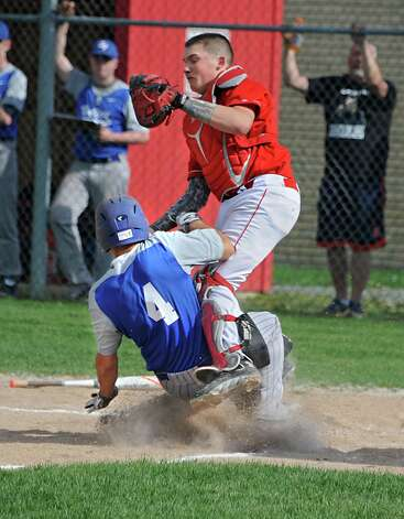 Hoosic Valley's Matt Espey, #4, is safe at home plate with Mechanicville's Peyton Kalteux missing the tag during a baseball game against Mechanicville on Tuesday, May 12, 2015 in Mechanicville, N.Y. (Lori Van Buren / Times Union) Photo: Lori Van Buren / 00031789A