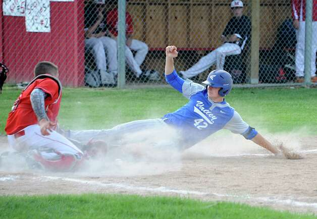 Hoosic Valley's John Rooney slides safely into home plate as Mechanicville's catcher Peyton Kalteux drops the ball during a baseball game on Tuesday, May 12, 2015 in Mechanicville, N.Y. (Lori Van Buren / Times Union) Photo: Lori Van Buren / 00031789A