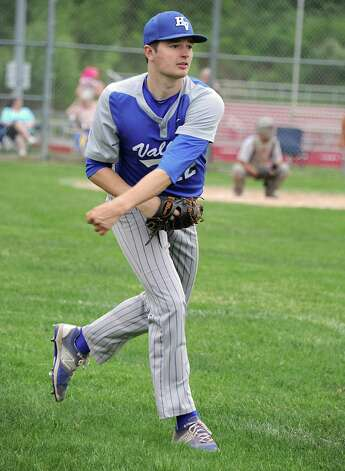Hoosic Valley's John Rooney warms up an outfielder during a baseball game against Mechanicville on Tuesday, May 12, 2015 in Mechanicville, N.Y. (Lori Van Buren / Times Union) Photo: Lori Van Buren / 00031789A