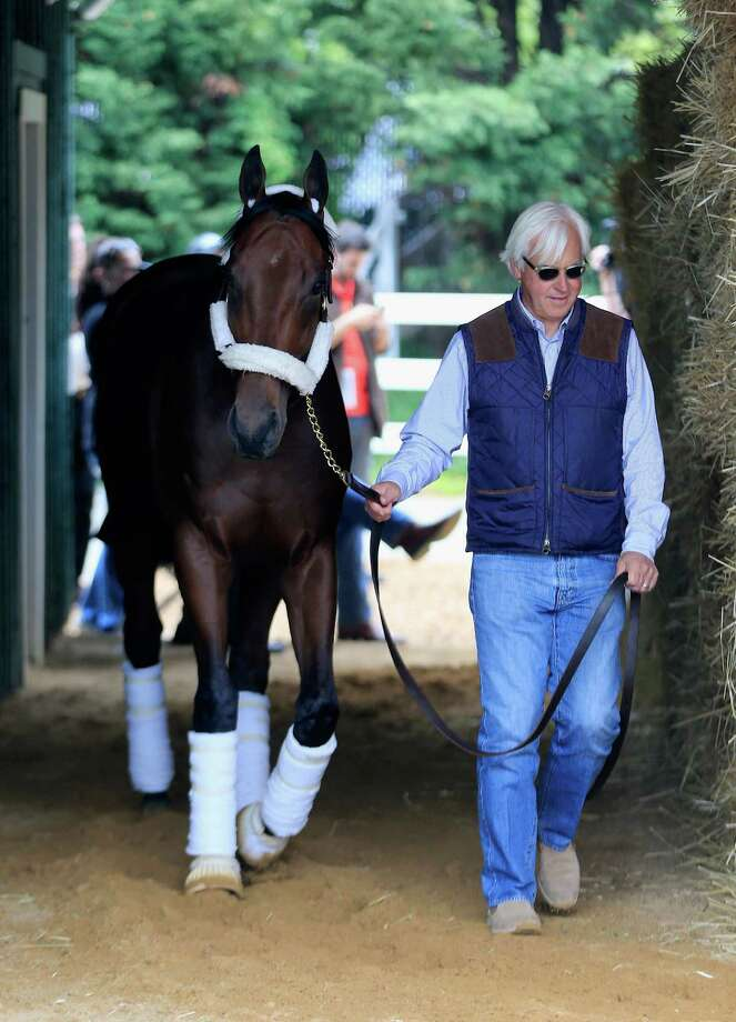 Trainer Bob Baffert likes the way American Pharoah is getting settled in the Pimlico barns, though he is not pleased with where he will be starting. Photo: Rob Carr, Staff / 2015 Getty Images