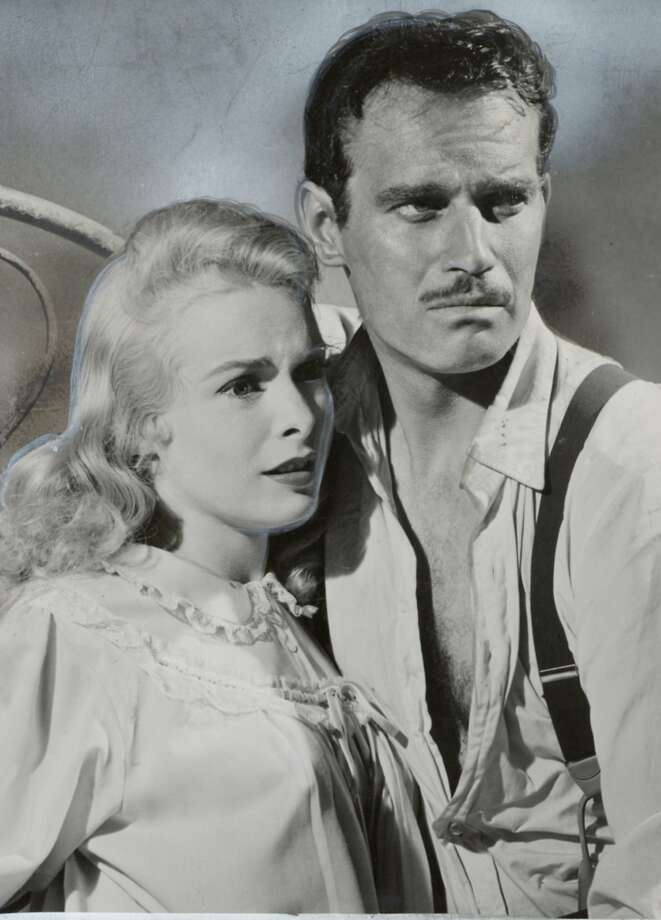 THIS IS A HANDOUT IMAGE. PLEASE VERIFY RIGHTS. COOLD-B-08FEB02-DD-HO TOUCH OF EVIL STARS JANET LEIGH AND CHARLTON HESTON  Ran on: 07-17-2011 Janet Leigh and Charlton Heston in &quo;Touch of Evil,&quo; playing today and Monday at the Red Vic. Photo: Handout, SFC